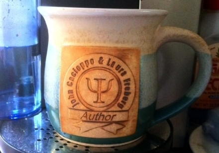 a beautiful coffee mug celebrating 7 years of research &amp; work